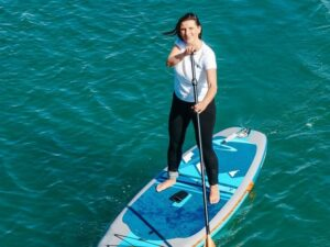 a woman on a paddleboard